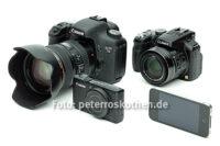 Wie viele Megapixel muss eine Digitalkamera haben? Unten links digitale Kompaktkamera, unten rechts Smartphone, links oben digitale Spiegelreflexkamera, rechts oben Bridgekamera.